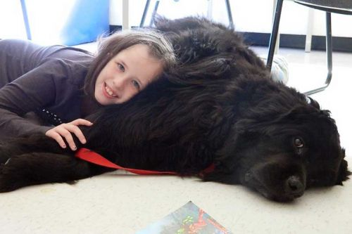 Kaleigh McKenna snuggles up to Chiclet. Photo by Adrienne Decou