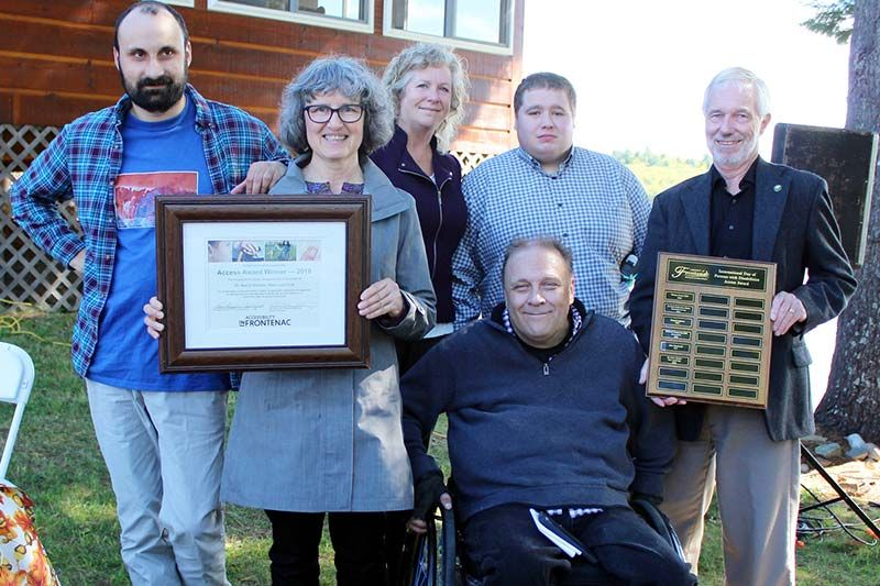 Dr. Karin Steiner of New Leaf Link accepts an Access Award from Warden Ron Higgins and Frontenac County accessibility advisory committee chair Neil Allen. Also in the photo are Julia Atherley, Nicolas Bell and Keifer Blight.