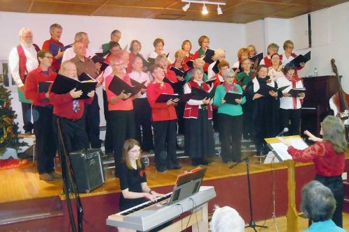 Rebecca Worden and accompanist Rachelle Reinhart lead the Tay Valley Community Choir who were joined by Fiddlers and Friends at the their annual Christmas concert in Maberly