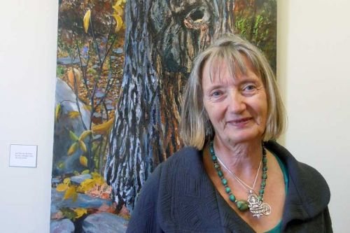 "Tree portrait painter Gwen Frankton with ""Ash Tree By The River"" at MERA"