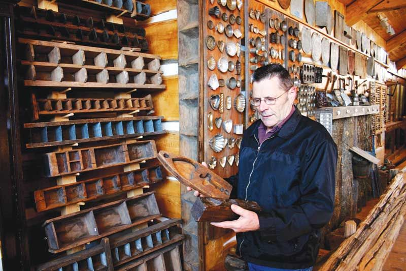 Vernon Wheeler with his vast collection of maple sugar moulds, photo courtesy of the Wheelers.