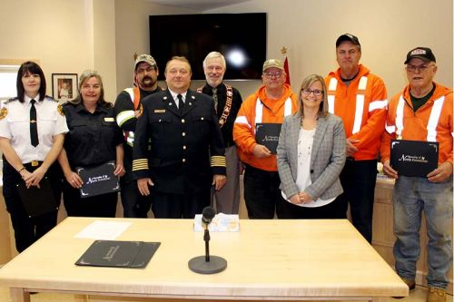 North Frontenac honoured long service of employees and fire volunteers at its regular meeting last week including Bill Hermer and Gregg Wise (20 years), Tim Neal (not in picture) and Dean Salmond (15 years), Tara Mieske, Randy Schonauer and Eric Korhonen (10 years) and fire volunteers Kevin Wheeler (Snow Road, 25 years, not in picture), Michelle Ross (Ompah, 10 years), Donna Schonauer (Clar-Mill, 10 years). Also pictured is Mayor Ron Higgins. Photo/Craig Bakay