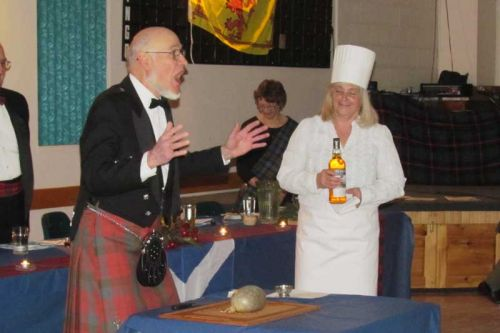 Gordon Sparks, addressing the haggis, and Pat Cuddy offering a wee dram.