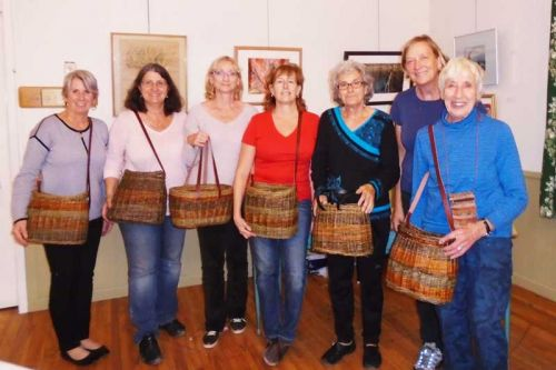 L-r: Jill, Nancy, Cheryl, Marilyn, Ruth, teacher Lene Rasmussen, and Ankaret Dean with their naturally colorful finished baskets.