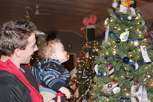 Porter Badour seems to have found his favourite tree with a helping hand from dad Zach Badour.