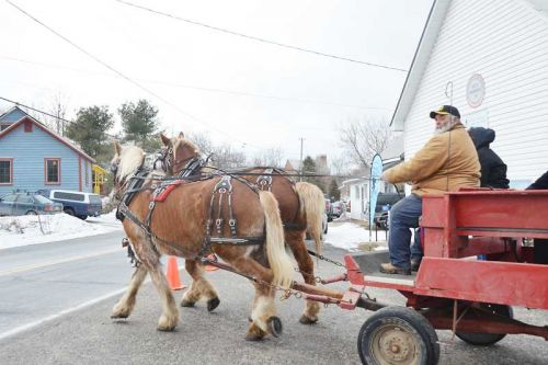 Cars on the Elphin-Maberly Road slowed when they saw this two-horse team pull out from the Maberly Hall and head to the fairgrounds during the Tay Bells Winter Celebration in Maberly on Saturday.