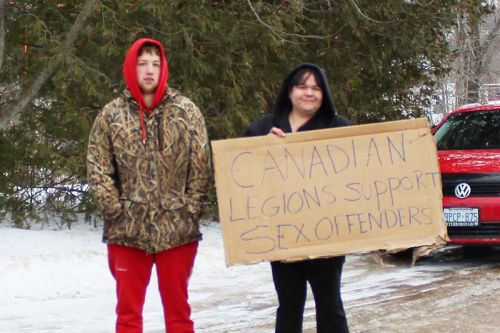 Members of Kingston Creep Watchers protested at the Sharbot Lake Legion Sunday.
