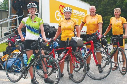 Sea to Sea riders at Frontenac Arena Deanna Bulsink from Edmonton, Anita Kralt from Bowmanville, Jim Haveman from Grand Rapids, Michigan and Andrew Ponsen from Burlington.