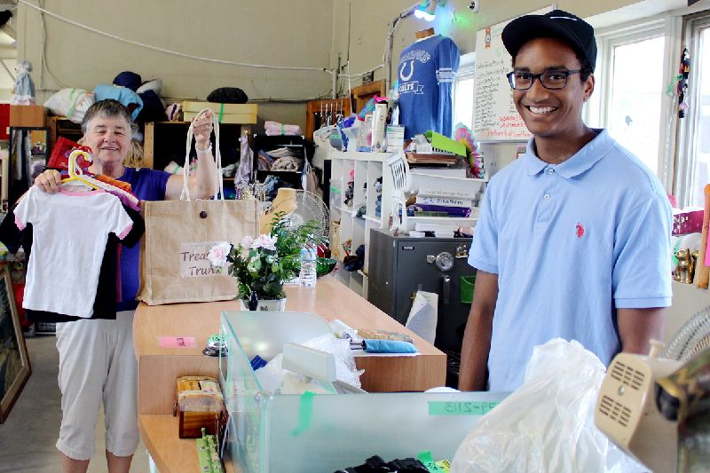 Caden Stephenson rings up Lillian Shepperd's purchases at The Treasure Trunk. Photo/Craig Bakay