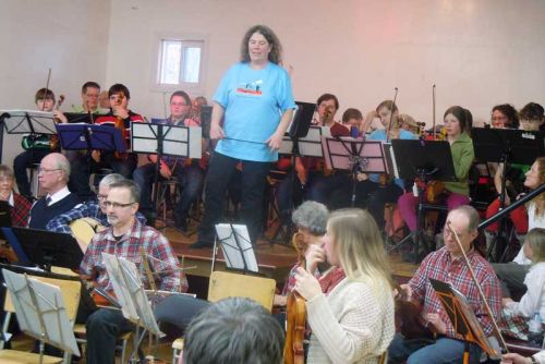 indy McCall leads the Blue Skies Community Fiddle and Prep orchestras at their annual Christmas Concert in Maberly where they were joined by the Celtic Heritage Fiddle Orchestra as well