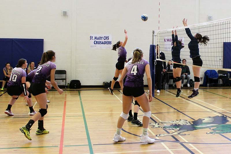 The St. Mary CHS Crusaders defeated the L'Heritage Dragons in the EOSSAA A senior girls volleyball final last week at GREC. Photo/Craig Bakay