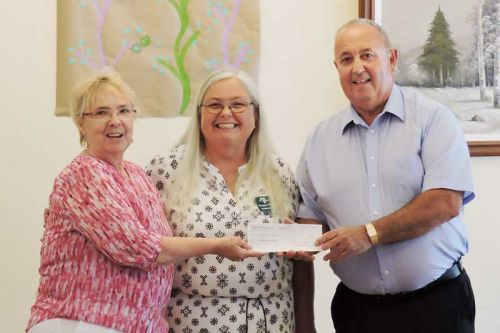 Frances Smith, Mayor of Central Frontenac presents Pine Meadow Nursing a cheque for $12,500 towards the window project