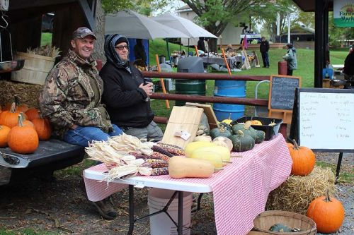 Ken Howes and Eric Zierer discuss their plans for the off season at the Sharbot Lake Farmers Market final gathering Saturday for 2018. Photo/Craig Bakay