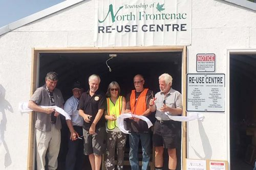 North Frontenac officially opened its Re-Use Centre last week with a ribbon cutting featuring (from left) Public Works Manager Darwyn Sproule, Coun. Gerry Martin, Mayor Ron Higgins, Volunteers Wendi and Dale Hudson and former public works manager Jim Phillips. Photo/submitted