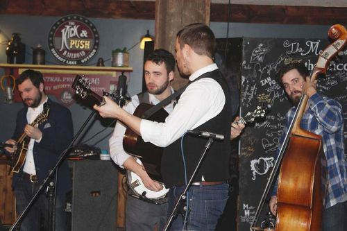 The Slocan Ramblers, Adrian Gross on mandolin, Frank Evans on banjo, Darryl Poulsen on guitar and Alastair Whitehead on bass, rocked The Crossing Pub on Saturday in night in Sharbot Lake. Photo/Craig Bakay
