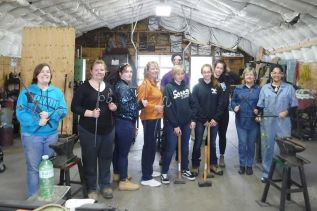 The female blacksmithing workshop attendees with Stefan Duerst