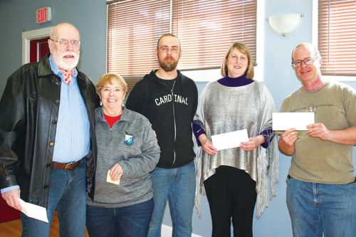 Rob Moore (centre), who organized the Polar Bear Plunge during the Frontenac Heritage Festival in February, was at Council Tuesday to, along with Mayor Frances Smith, present cheques to Ray Fletcher representing Northern Connections ($1,089.57), Maria Lockhart representing the Treasure Trunk ($1,277.67) and Isaac Hale representing the Central Frontenac Fire Department ($977.67). Photo/Craig Bakay