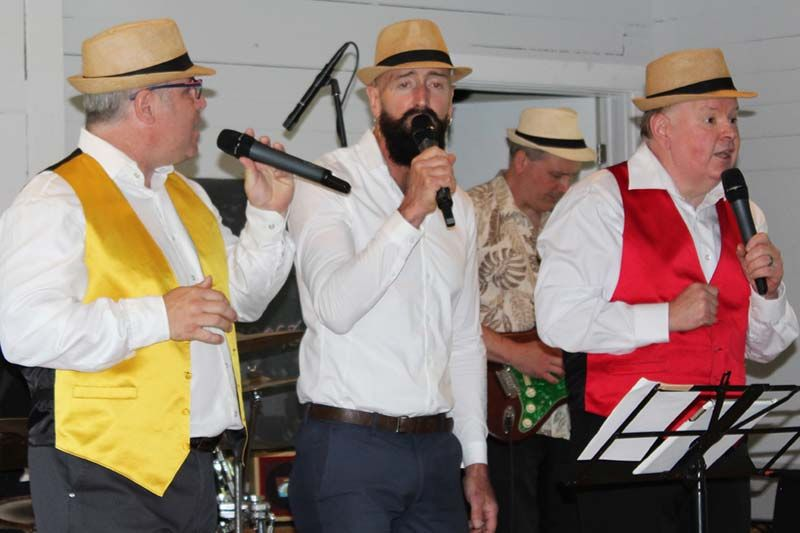 The Kings Town Tenors, (from left) Danny Young, Tim Torgersen and Jack Francis singing up a storm in the Bellrock Hall Sunday. Photo/Craig Bakay