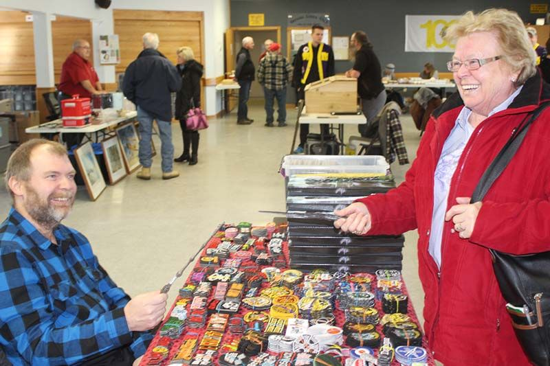 Pat Willman and Sheila Calthorpe face off in a wizard's duel with the Harry Potter wands Willman was selling at the Verona Lions Vendors Market Saturday in Verona. Photo/Craig Bakay